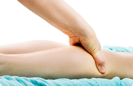 Woman having a deep tissue massage at claire durand beauty salon in fulham
