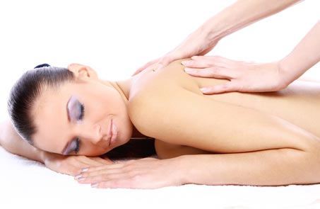 Client receiving a therapeutic massage at claire durand beauty salon in fulham